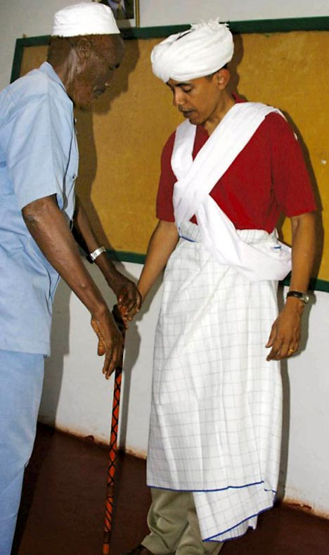 Mr Obama - whose father was Kenyan - being dressed as a tribal elder during an official visit to a Muslim area of the country in 2006.